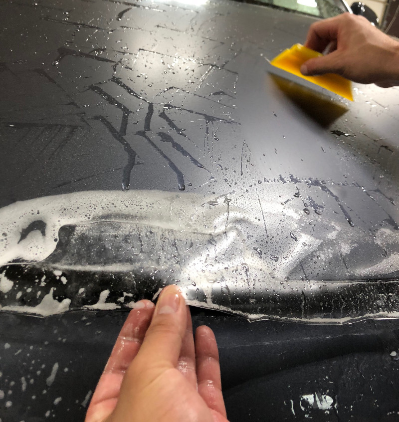 Protection film being sealed to a vehicle